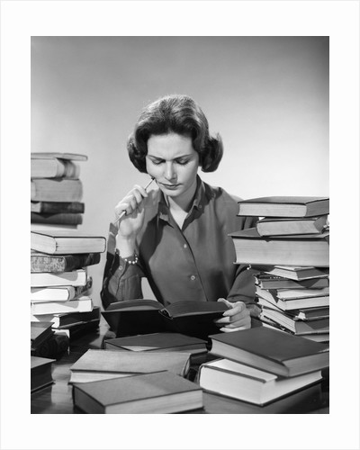 1950s 1960s College Woman Studying Surrounded All Around By Piles Of Books by Corbis