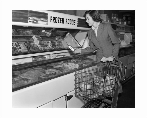 1950s Woman Shopping Frozen Food Section Of Grocery Store by Corbis