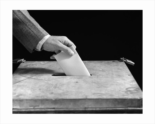 1930s 1940s Male Hand Dropping Paper Ballot In Voting Box by Corbis
