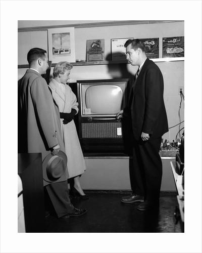 1950s Couple With Salesman In Electric Appliance Store Shopping For Television by Corbis