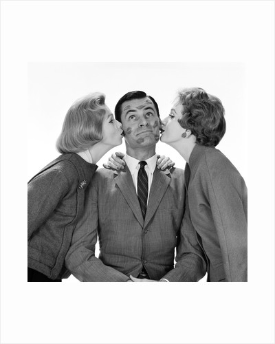 1950s Two Women Kissing Single Man On Opposite Cheeks His Face Covered With Lipstick Marks by Corbis