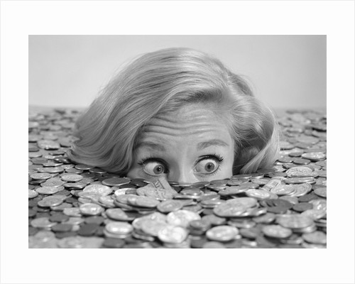 1960s Bug-Eyed Surprised Woman Buried In Coins Money Symbolic by Corbis