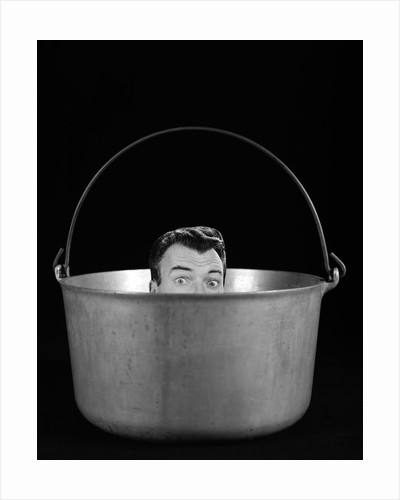 1950s 1960s Symbolic Montage Portrait Man In The Soup Looking Wide Eyed From Inside The Kettle by Corbis