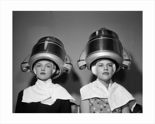 1950s Two Women Under Hair Dryers Towels Around Shoulders Hair Nets by Corbis