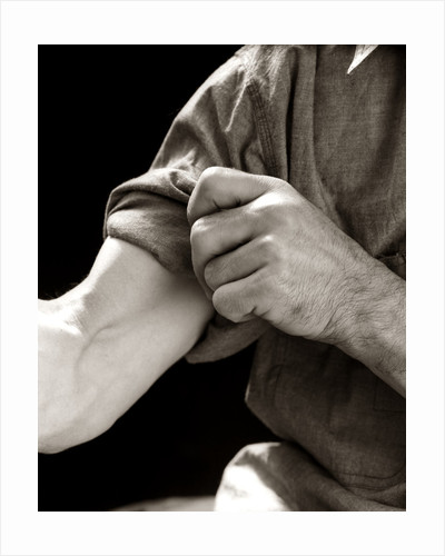 1920s 1930s 1940s 1950s Man Rolling Up Sleeve Symbolic Get To Work by Corbis