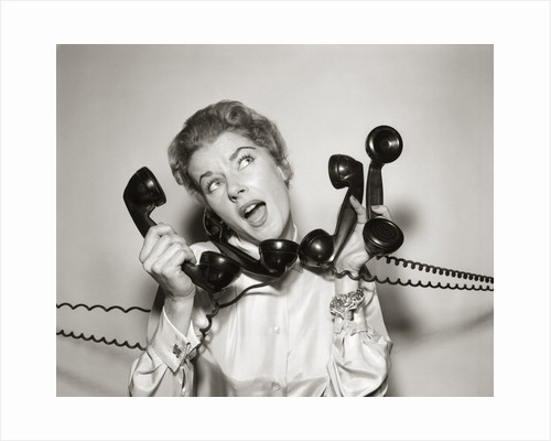 1950s 1960s Overwhelmed Stressed Woman Answering Four Black Telephone Phone Receivers At One Time by Corbis