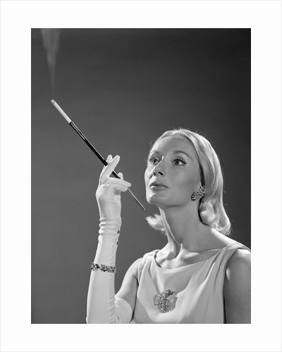 1960s Elegant Woman Wearing Gown With French Cigarette Holder by Corbis