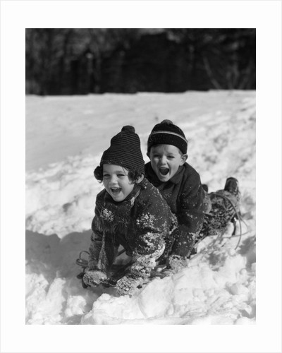 1930 1930s Boy And Girl Laughing Sledding In Snow by Corbis
