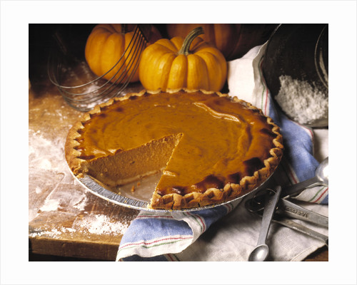 Pumpkin Pie with Slice Removed by Corbis