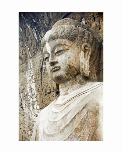 Colossal Buddha Sculpture at Fengxian Temple of Longmen Grottoes by Corbis
