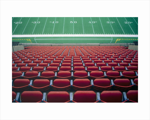 Empty seats in stadium by Corbis