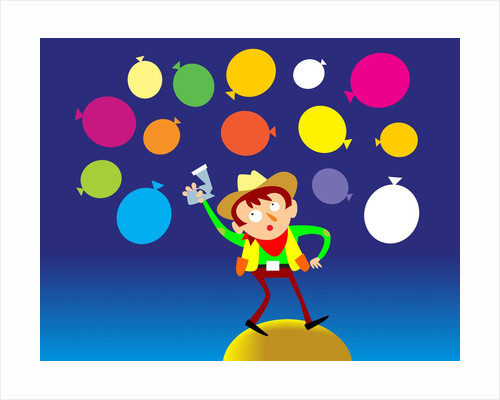 Boy in cowboy costume with balloons by Corbis