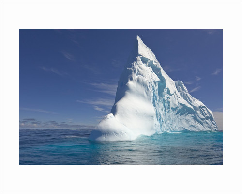 Pointy Blue Iceberg Sculpted by Waves by Corbis