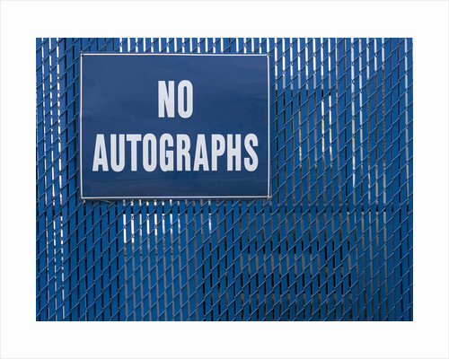 Sign on Chain-link Fence by Corbis