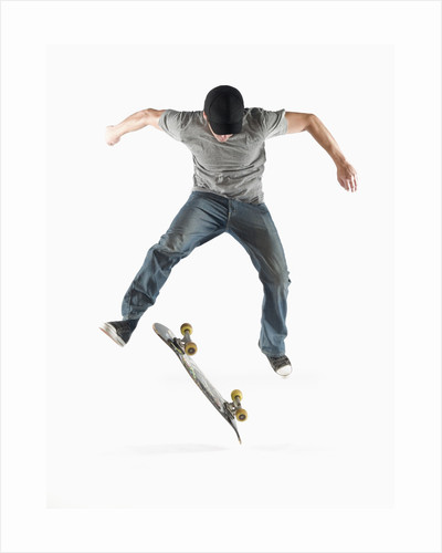 Young Skateboarder Doing Trick by Corbis