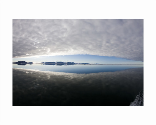 Reflection of Low Clouds in Calm Sea at Edgeoya Island by Corbis