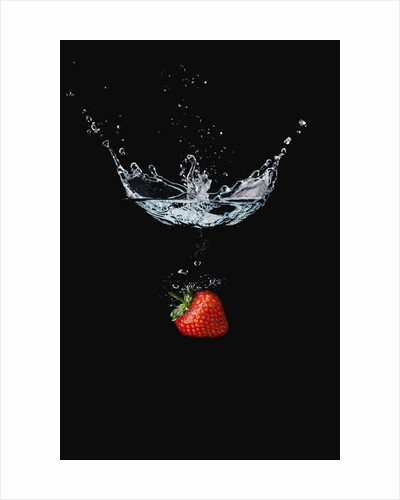 Strawberry in Water by Corbis