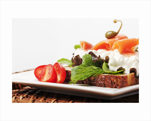 Open faced salmon and cottage cheese sandwich by Corbis
