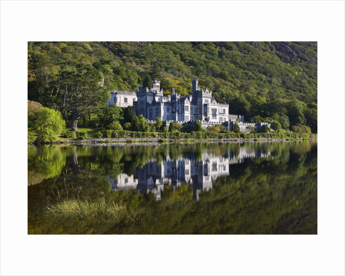 Kylemore Abbey reflected in lake by Corbis