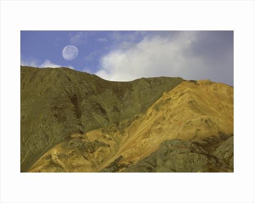 Full moon setting over mountain in Kluane National Park by Corbis
