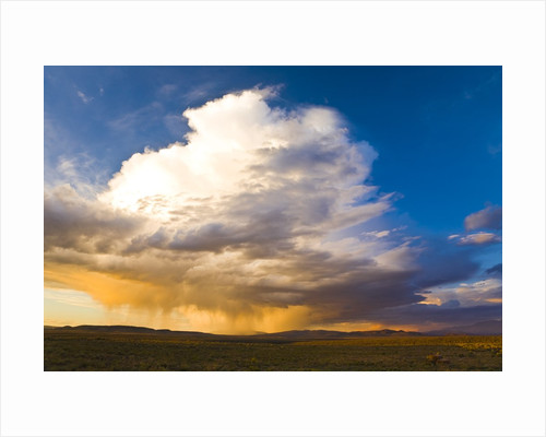 Rain clouds moving across landscape by Corbis
