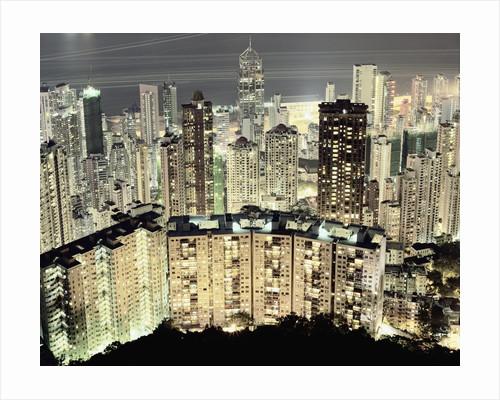 Hong Kong skyscrapers and apartment blocks at night by Corbis
