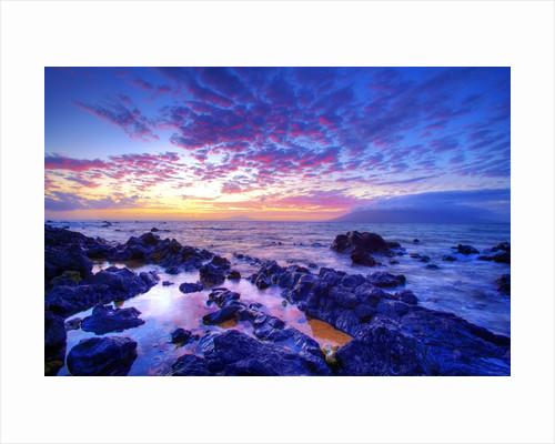 Sunset over beach at Wailea on Maui by Corbis