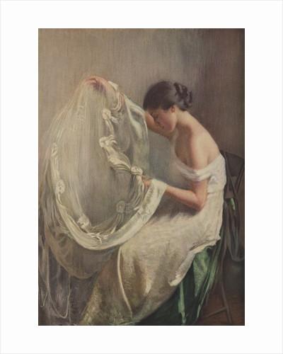 Woman sewing wedding veil by Corbis