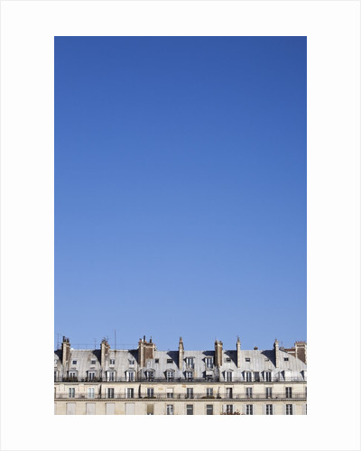 Rooftop facade of apartment houses, Paris, France by Corbis