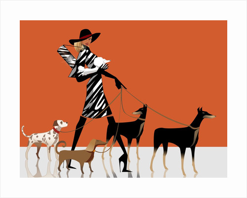Side profile of a woman walking with her dogs by Corbis