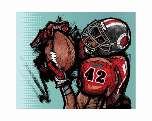 American football player holding football by Corbis