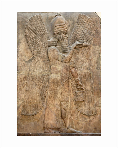 Assyrian relief of winged genie by Corbis