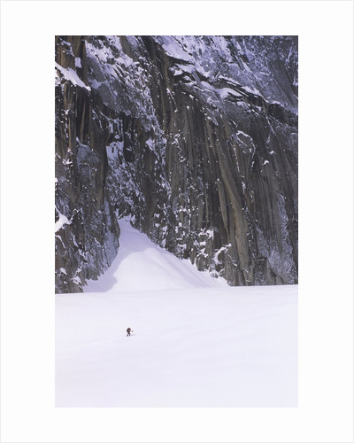Backcountry Skier Underneath Snowpatch Spire, Bugaboos, British Columbia, Canada. by Corbis