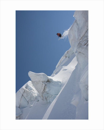 Back country skier jumping off mountain by Corbis