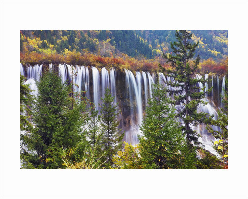 Nuorilang Waterfall and forest in autumn by Corbis