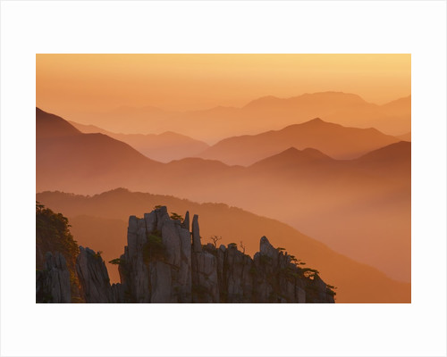 Yellow Mountains silhouetted in haze in China by Corbis