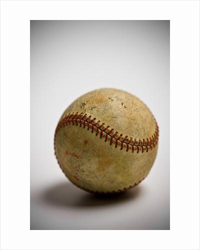 Close-up of worn baseball by Corbis