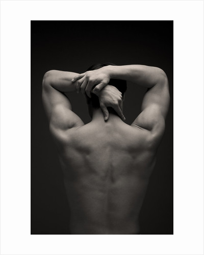 Rear view of a male stretching his arm behind his head by Corbis