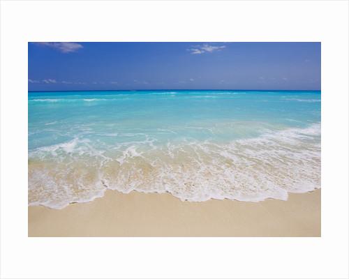 White sand beach in Cancun by Corbis