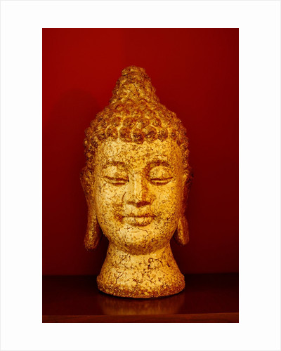 Buddha head by Corbis