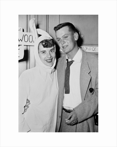 A couple on a date at a costume party pose, ca. 1955 by Corbis