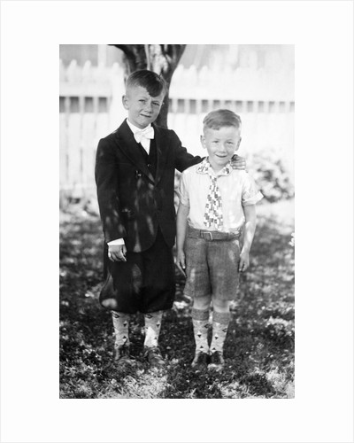 Two brothers pose in the backyard, ca. 1930 by Corbis