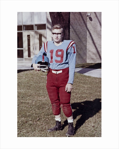 Fifteen year old high school football player portrait outside the school, ca. 1961 by Corbis