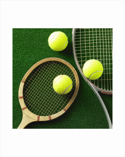Tennis racket and tennis ball by Corbis