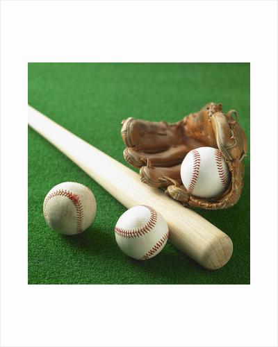 A baseball, gloves and a bat by Corbis