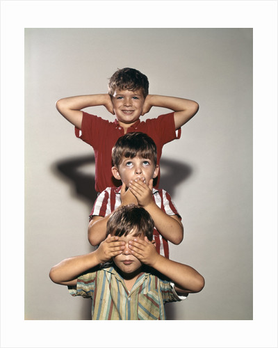 Boys posing as three wise monkeys see no evil hear no evil speak no evil by Corbis