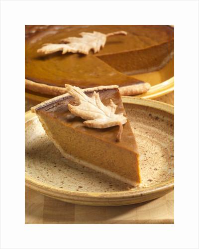 Slice of Pumpkin Pie with Pastry Leaf Garnish by Corbis