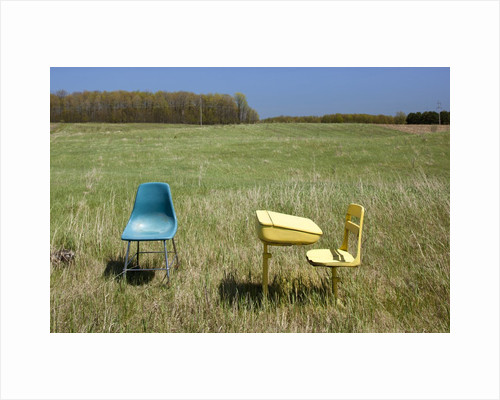 Abandoned school desk and chairs in farmer's field by Corbis