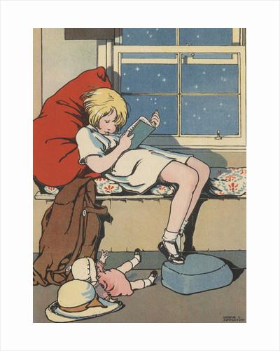 Girl reading book by Corbis