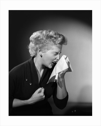 1950s woman sneezing cold by Corbis